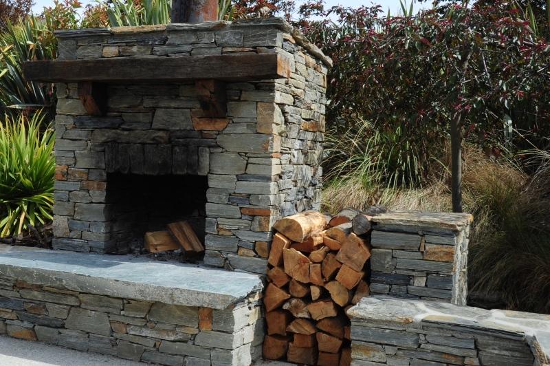 outdoor schist fireplace